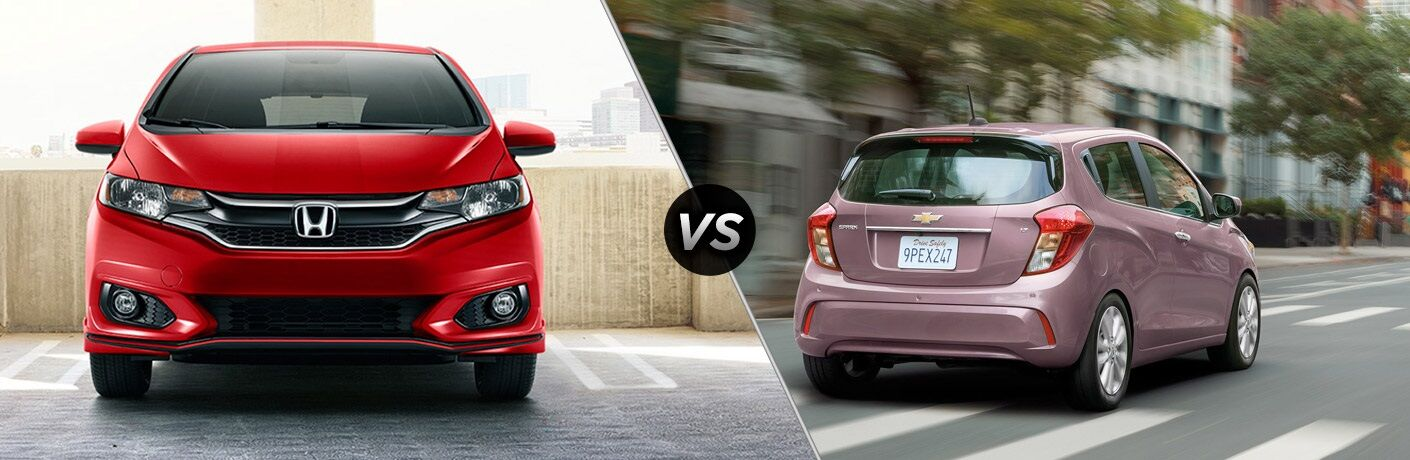 Red 2019 Honda Fit and pink 2019 Chevy Spark side by side