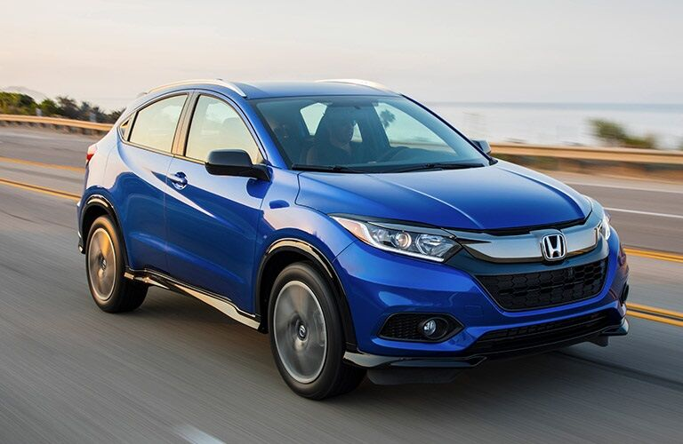 Blue 2019 Honda HR-V driving on open road