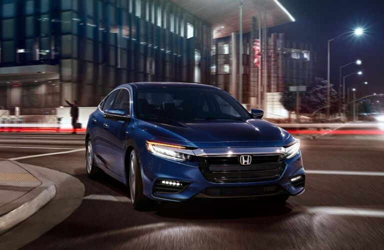 Blue 2019 Honda Insight making a right turn