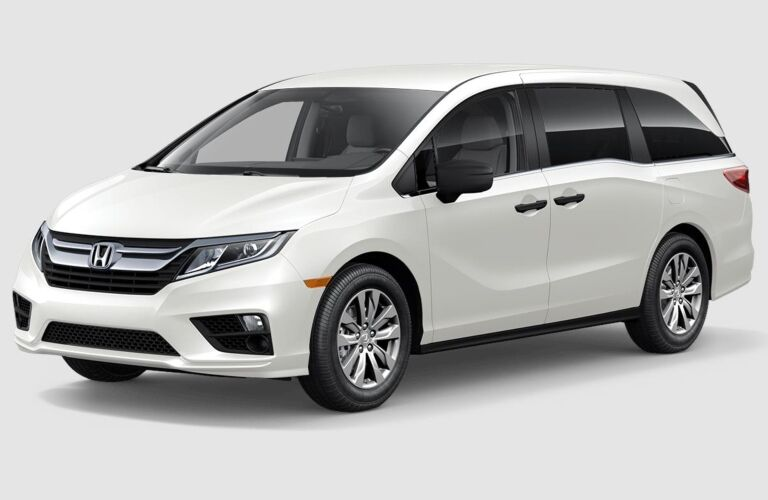 White 2019 Honda Odyssey on a gray background