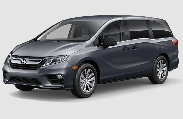 Dark gray 2019 Honda Odyssey on a gray background