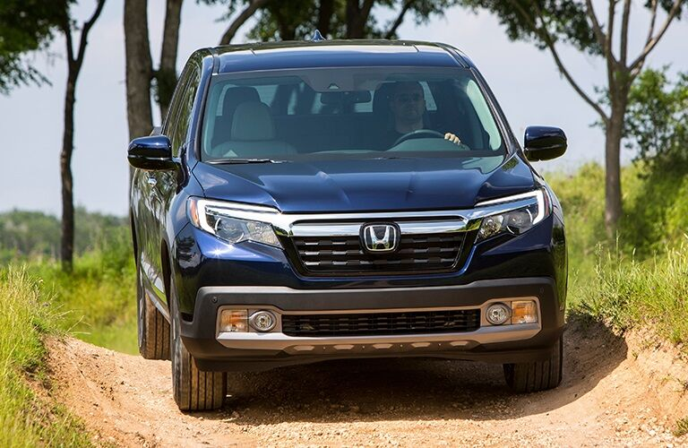 Front view of a 2019 Honda Ridgeline driving off road