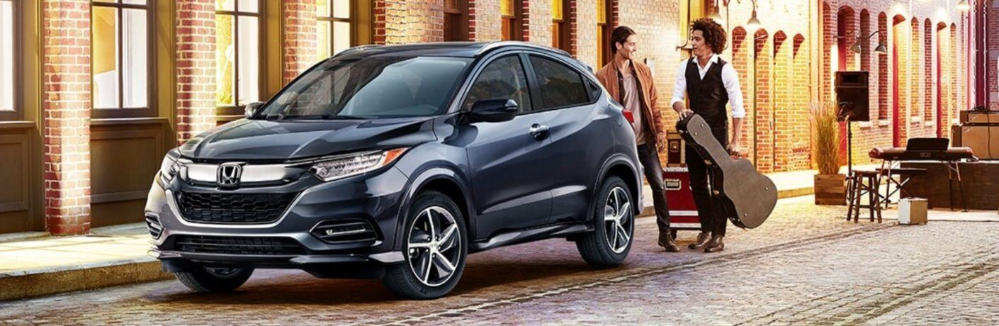 2020 Honda HR-V with two men standing behind the vehicle talking