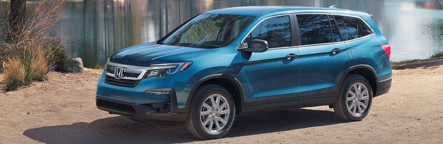 Side view of a blue 2020 Honda Pilot