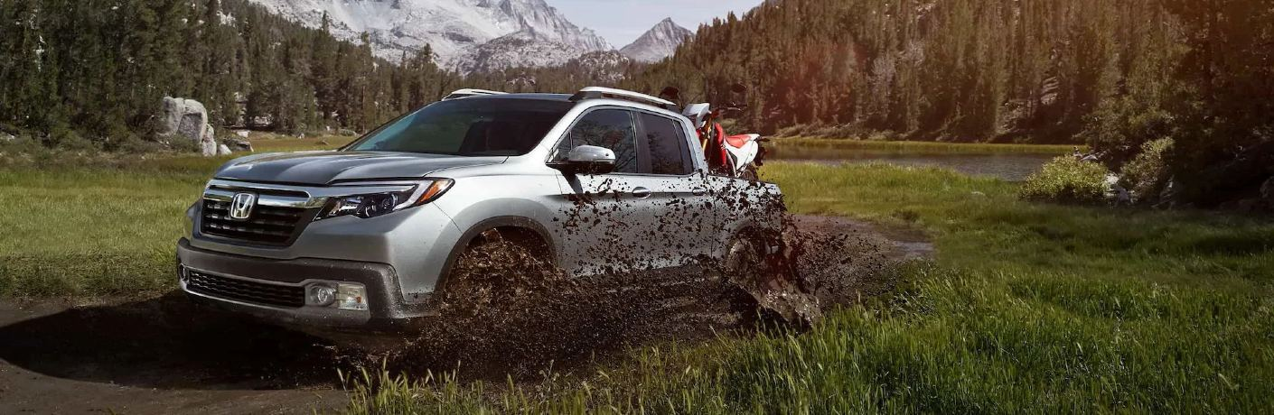 2020 Ridgeline driving through muddy field