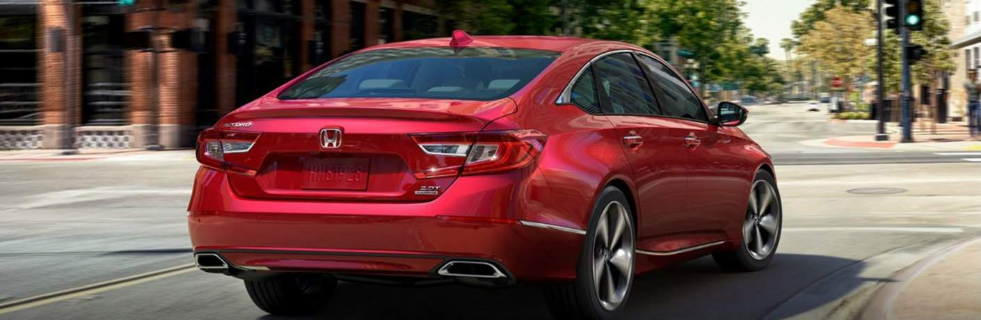 Rear view of red 2018 Honda Accord driving on city street