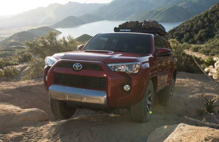 red 2017 Toyota 4Runner driving off-road