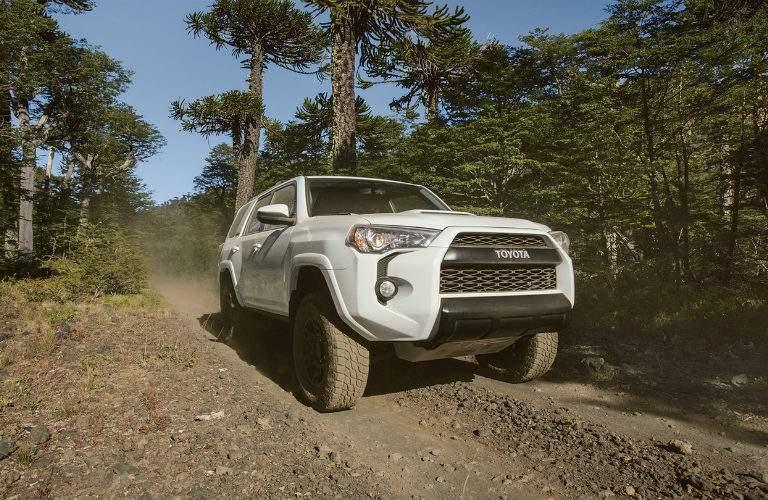 white 2017 Toyota 4Runner driving off-road