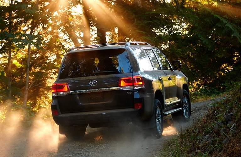 Rear view of the 2017 Toyota Land Cruiser driving off-road
