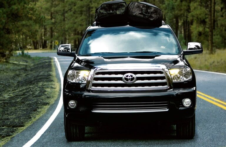 2017 Toyota Sequoia driving with luggage on top