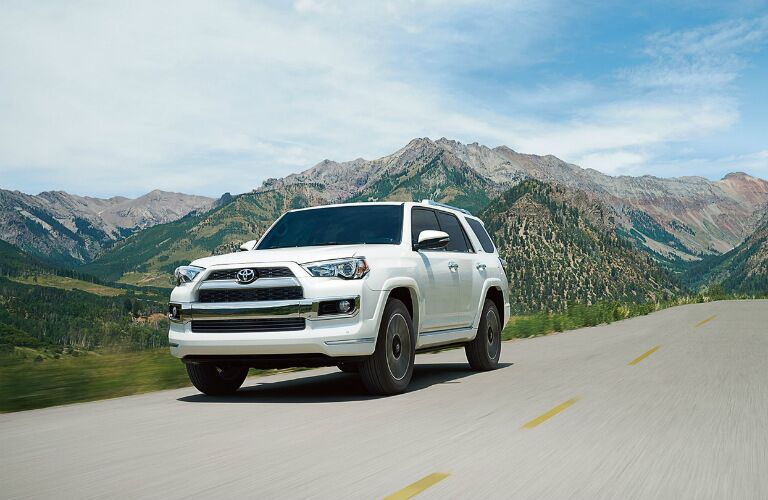 White 2018 Toyota 4Runner driving by mountains