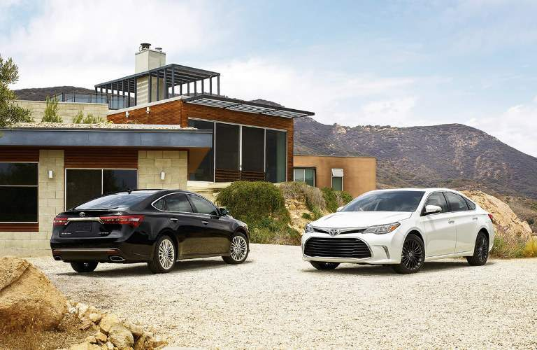 two 2016 Toyota Avalon models parked side by side
