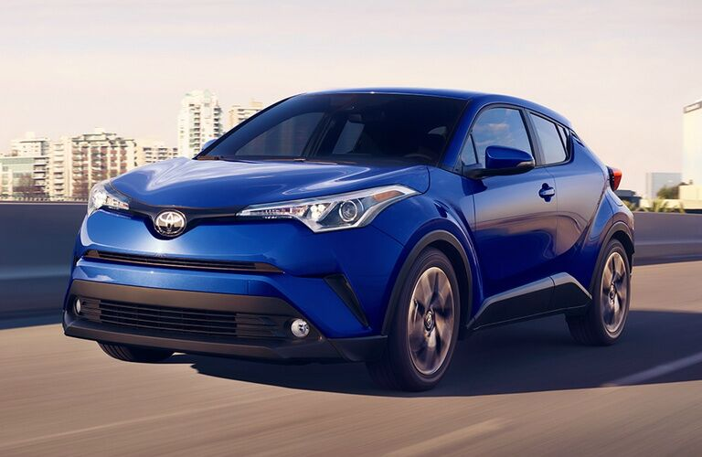 blue 2018 Toyota C-HR driving on highway