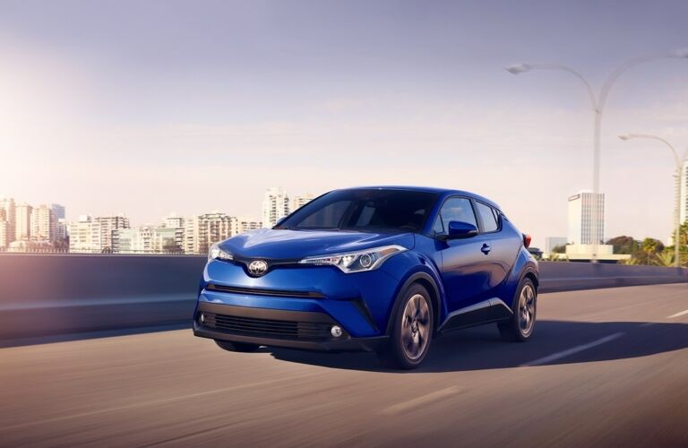 Blue 2018 Toyota C-HR driving along the highway