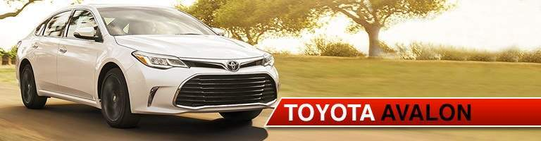 white 2018 Toyota Avalon driving on sunny day