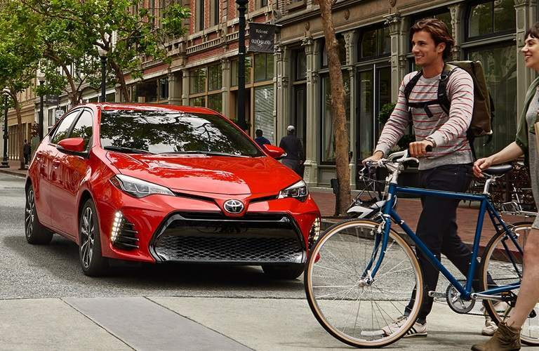 red 2018 Toyota Corolla parked at a crosswalk