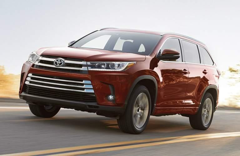 red 2018 Toyota Highlander making a left turn