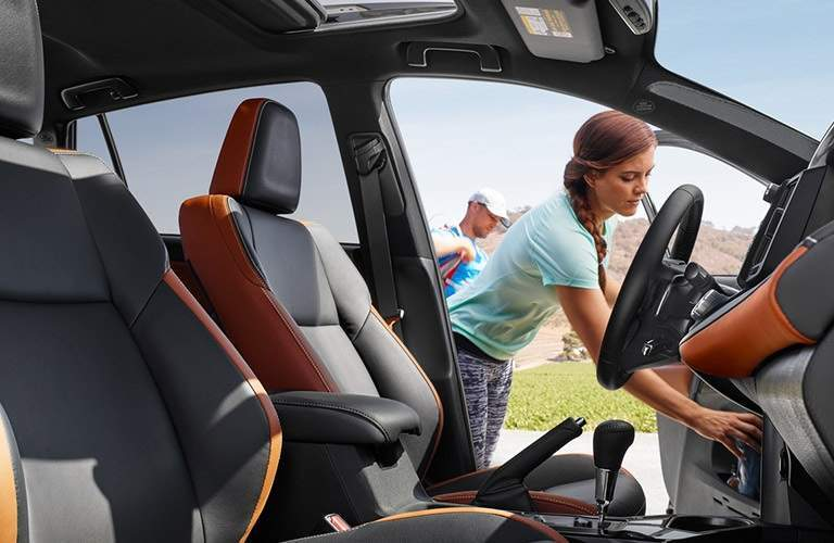 woman opening the driver door of the 2018 Toyota RAV4