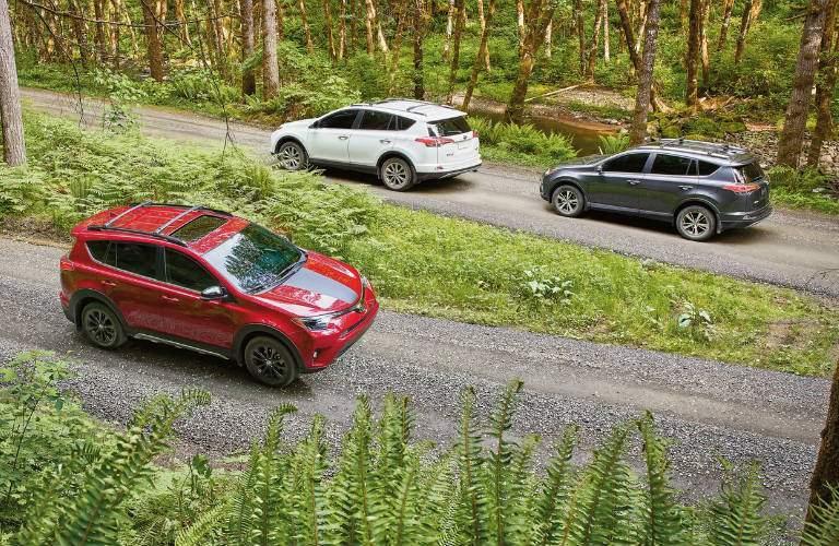 2018 Toyota RAV4 models passing each other on gravel road