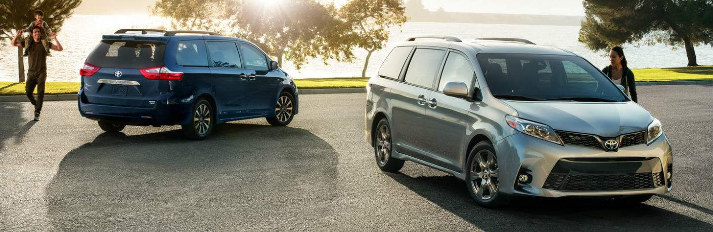 blue and silver 2018 Toyota Sienna models parked next to each other
