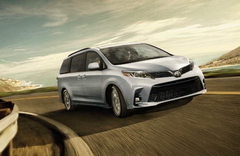 silver 2018 Toyota Sienna making a right turn