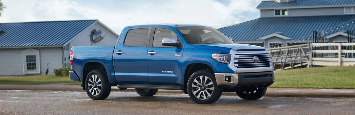 blue 2018 Toyota Tundra parked in front of building