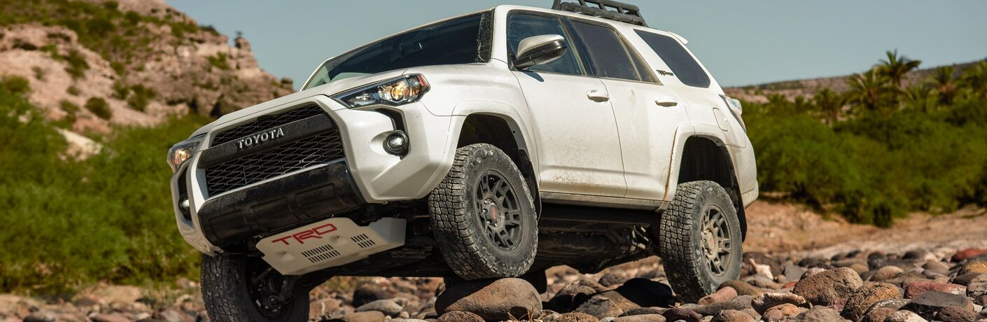 White 2019 Toyota 4Runner driving over rocks