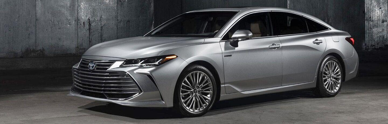 Silver 2019 Toyota Avalon on a grey background