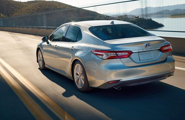 Silver 2019 Toyota Camry driving along bridge