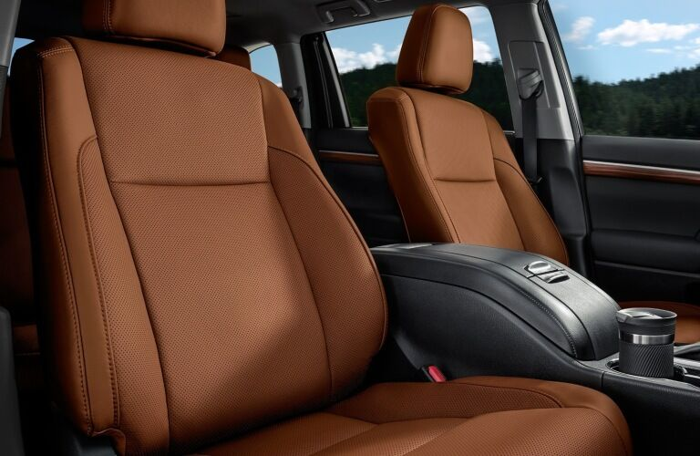 Interior front seats of the 2019 Toyota Highlander Hybrid