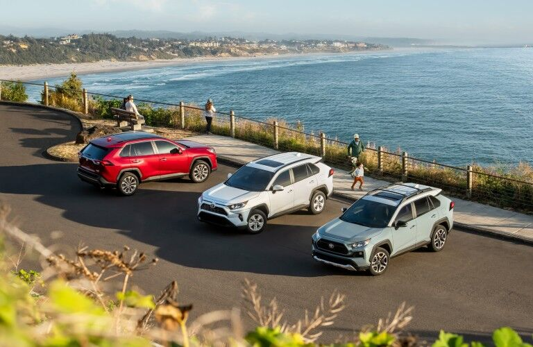 Overhead view of three 2019 Toyota RAV4 SUVs in a parking lot