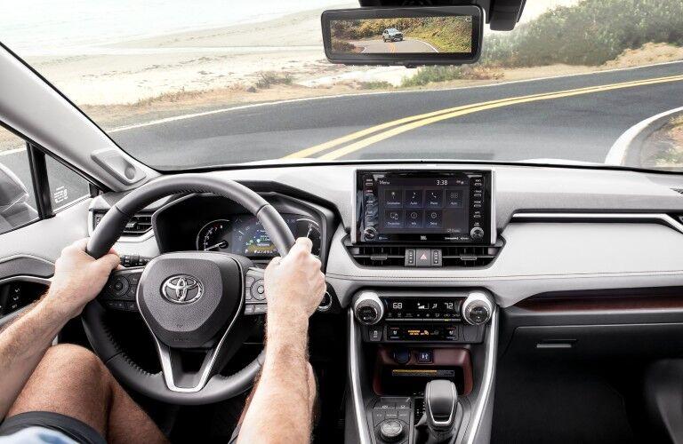 Man driving a 2019 Toyota RAV4