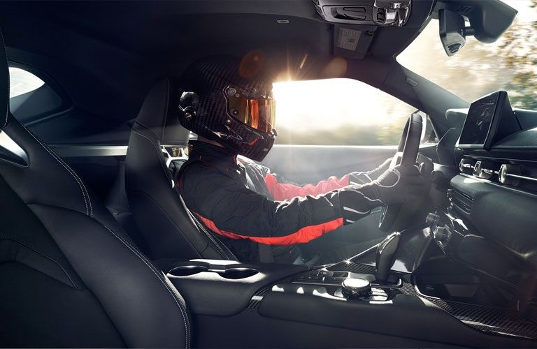 Driver behind the wheel of a 2020 Toyota GR Supra