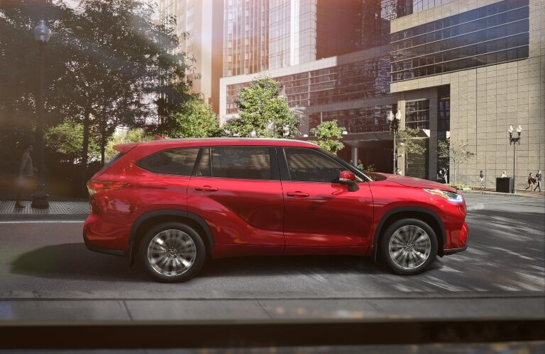Side view of a red 2020 Toyota Highlander in the city