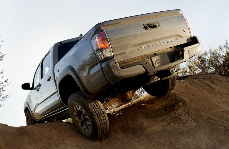 2020 Toyota Tacoma driving on uneven terrain