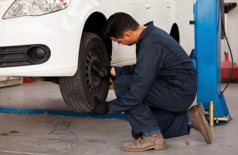 car technician rotating a tire