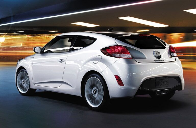 White 2016 Hyundai Veloster driving at night
