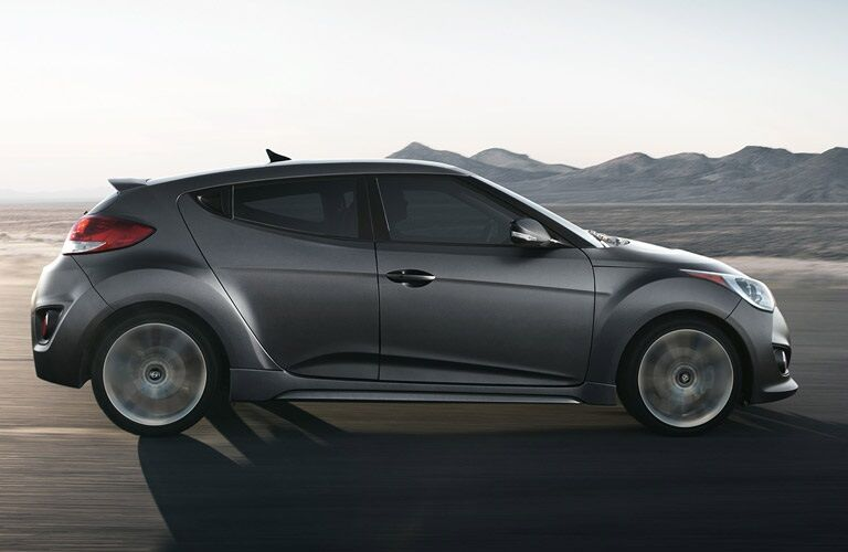 side view of 2016 Hyundai Veloster driving on road