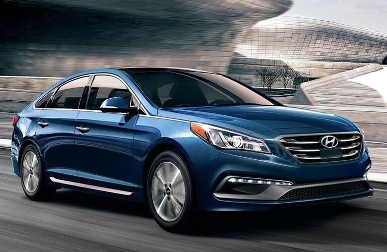 Blue 2017 Hyundai Sonata driving on highway
