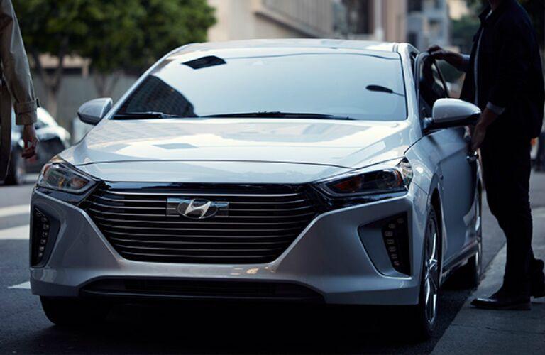 two people getting into a 2017 Hyundai Ioniq