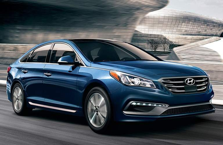 Blue 2017 Hyundai Sonata driving on highway