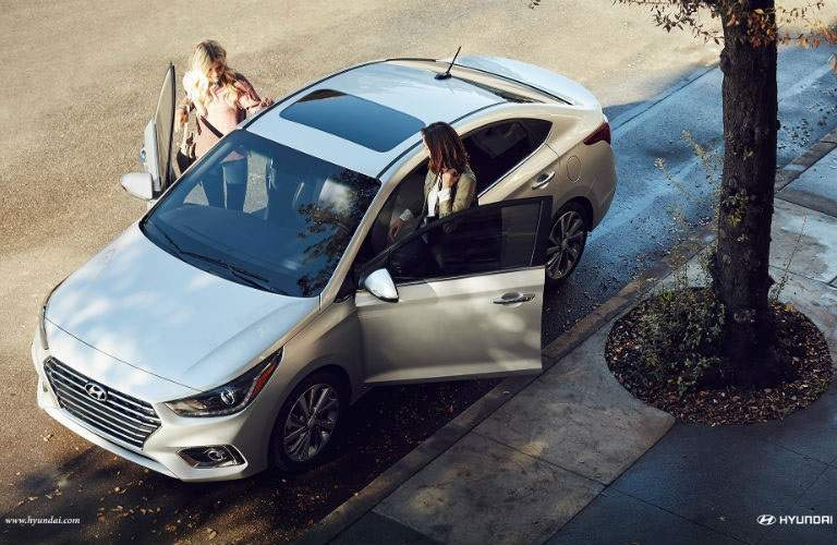 Overhead view of two women getting into the 2018 Hyundai Accent