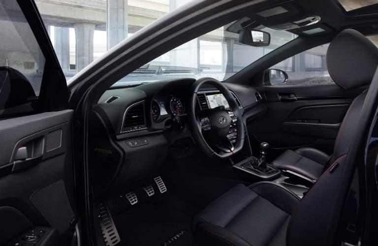 driver's door open on the 2018 Hyundai Elantra