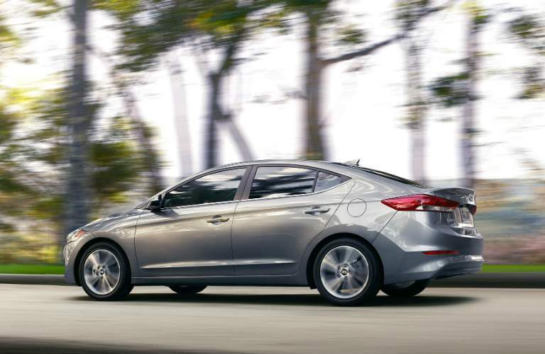 silver 2018 Hyundai Elantra driving on open road