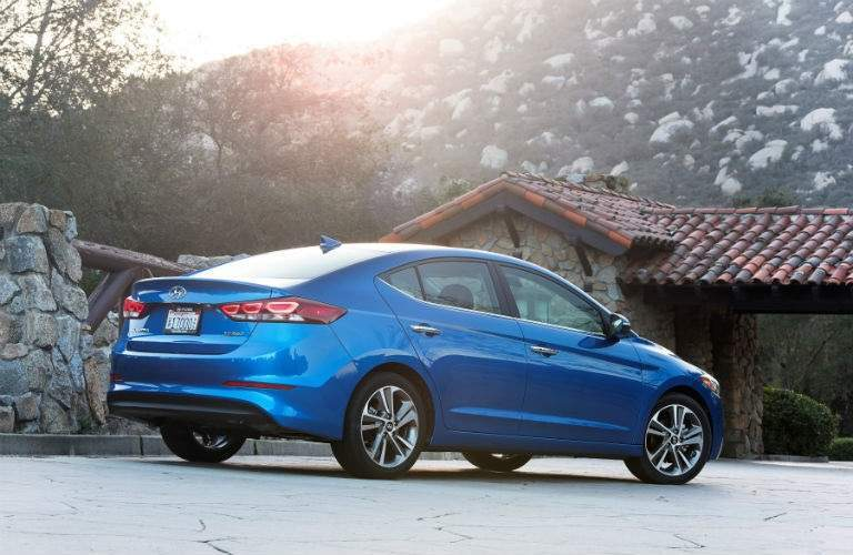rear side view of a blue 2018 Hyundai Elantra