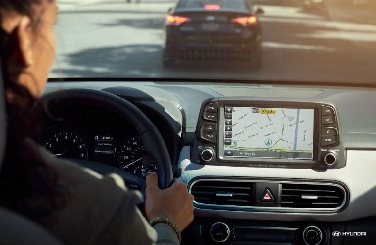 Woman using the navigation on the 2018 Hyundai Kona