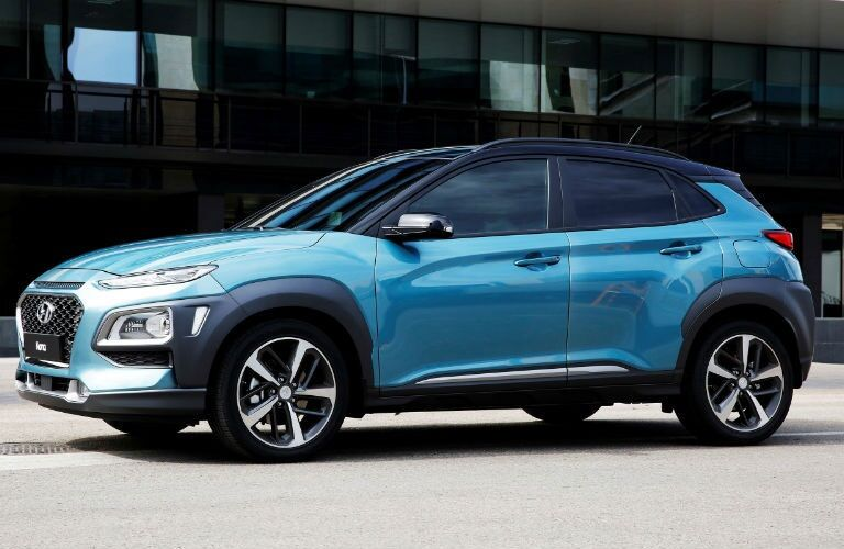Side view of a blue 2018 Hyundai Kona