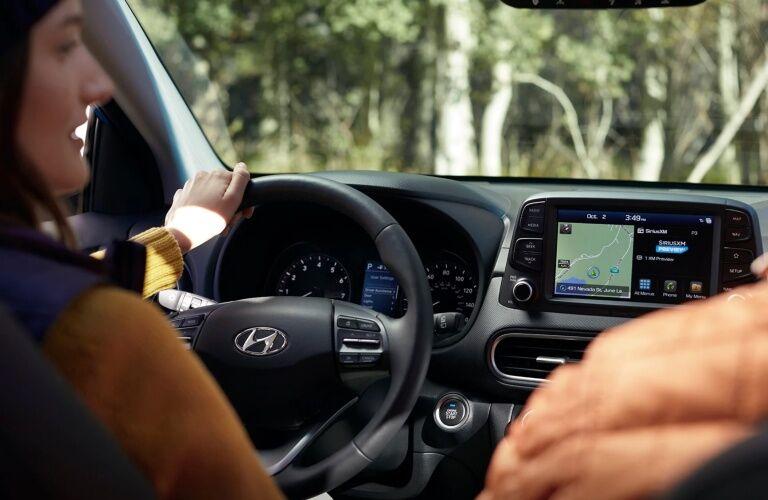 Woman behind the wheel of a 2019 Hyundai Kona