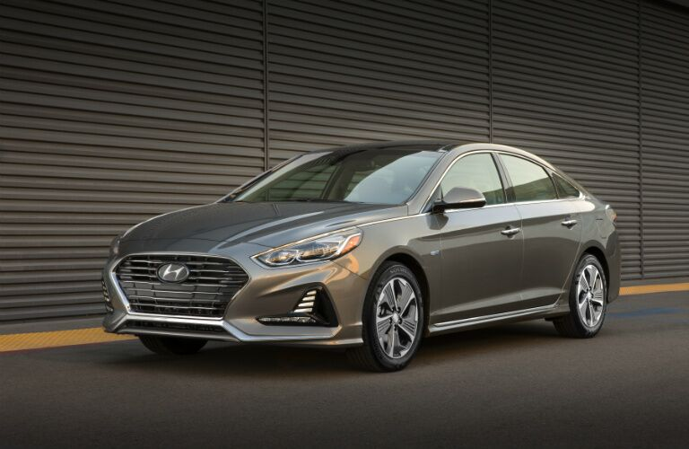 Grey 2018 Hyundai Sonata Hybrid parked in front of wall