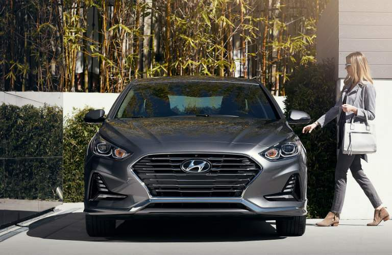woman getting in to drive the 2018 Hyundai Sonata
